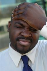 man slapping his head