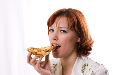 woman eating pizza on white