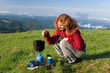 hiker girl making a coffee