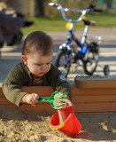 playing in the sand pit poster