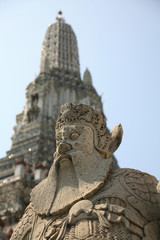 chinese guard statue at wat arun, bangkok thailand