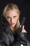 sexy woman with gun in leather jacket poster