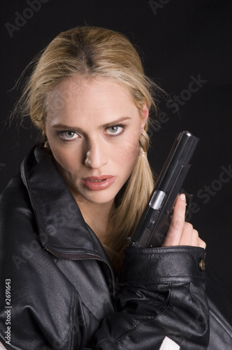 sexy woman with gun in leather jacket