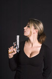 sexy blond with semi-automatic pistol poster
