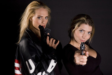 two woman with guns