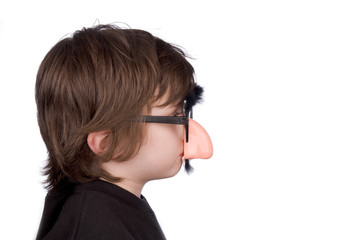 boy wearing fake nose and glasses