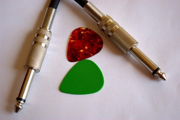 guitar picks and cable jacks