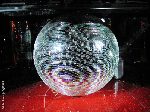 huge mirror sphere in a night club