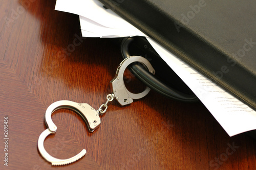 briefcase and handcuffs