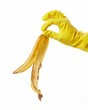 hand in yellow rubber glove with a banana peel 4