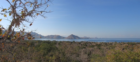 large view of the komodo island and the mountains over the sea,