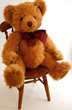 Leinwandbild Motiv teddy bear sitting on a chair