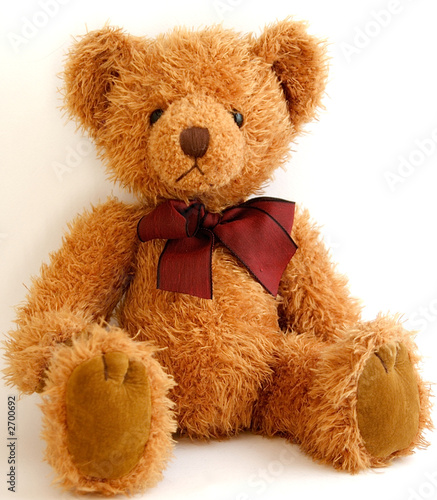 Leinwanddruck Bild teddy bear with red bow sitting