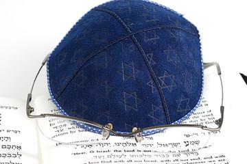jewish kippah, eyeglasses and shema