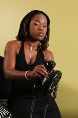 african american woman throwing phone