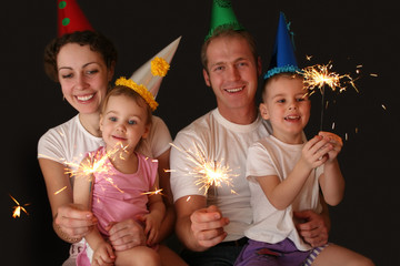 family of four with sparklers