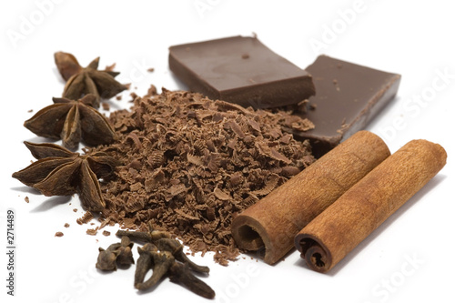 grated chocolate with spices isolated on white