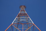 red triangular power tower in the blue sky poster