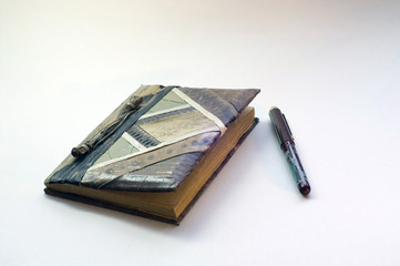 old notebook and pen