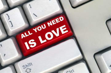 keyboard with red button of all you need is love