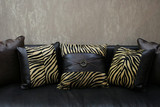 modern sofa with leopard skin cushions (copy space) - home inter poster