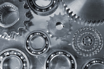 gears and bearings against steeel backdrop