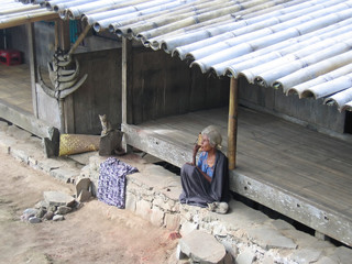 a woman and her cat out of our time, bajawa, flores, indonesia