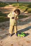 boy playing control car