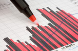 pen showing diagram on financial report/magazine poster