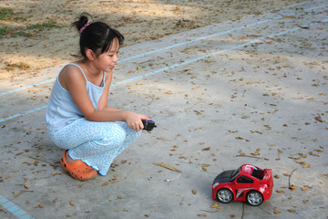 girl playing remote control car