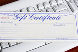 keyboard with a gift certificate poster