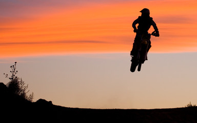 desperado (motorcycle jump at sunset)