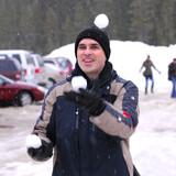 man juggle snowballs poster