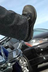 vertical shot of a biker stuck in traffic