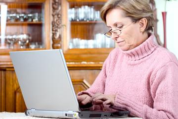 mature woman using notebook