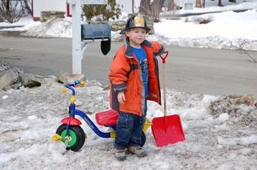 little fireman w/snow shovel