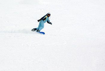 a girl riding fast on the snowboard