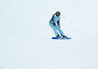 a girl riding on the snowboard
