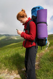 backpacker girl with phone poster