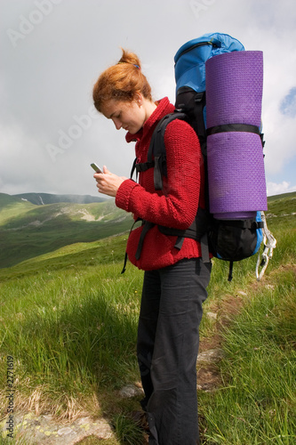 backpacker girl with phone