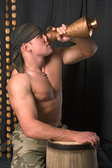 the soldier drinks from a jug