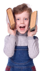 the boy with books smiles