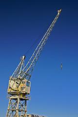 harbour crane against blue sky