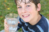 boy drinking a glass of water smile poster