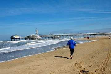 a man is running on the beach