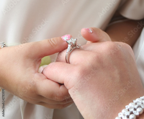 diamond ring and hands