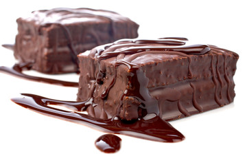 two chocolate cakes with syrup