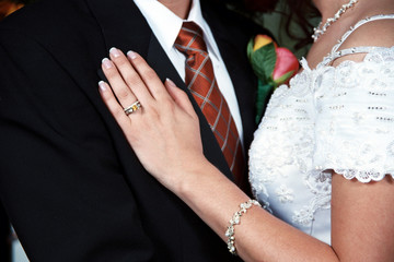 brides hand on grooms lapel