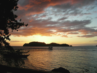 sunset over a tropical beach, togians island, sulawesi, indonesi