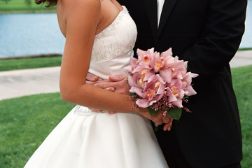 close up of bridal couple and bouquet